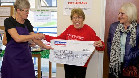 The Nellie's Community Café team presented a cheque for £550 to Fenprobe, the talking newspaper for