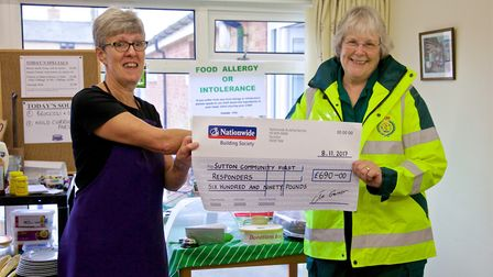 The Nellie's Community Café team donated £690 to Carrie Stanger of Sutton Community First Responders