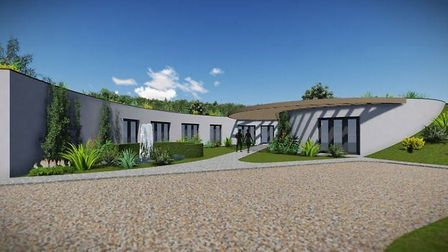 A family is business is hoping to be allowed to build Fenland's first earth sheltered house at Goref