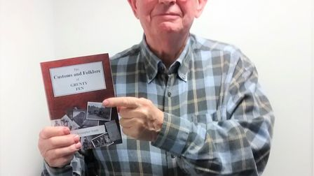 Chris South shows off his latest book, 'The Customs and Folklore of Grunty Fen.'