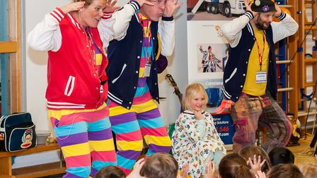 A youngster at Dunmow St Mary's helps The Laughter Specialists show how they cheer up children in ho