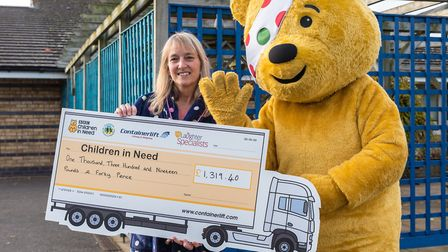 Headteacher at Dunmow St Mary's Clare Griffiths with Pudsey and the cheque for Children in Need. Pic
