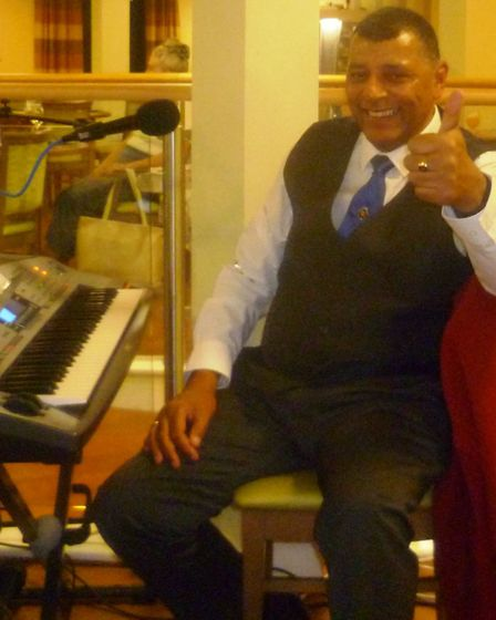 Residents at Soham care home enjoy music and annual fish and chip supper. Tony singing swing music p