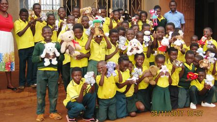 Children from the Fens have donated teddy bears to these pupils in Zambia.