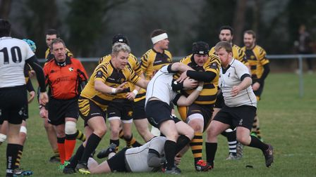 Adam Featherstone tries to break through the Holt defence. Photo: Steve Wells