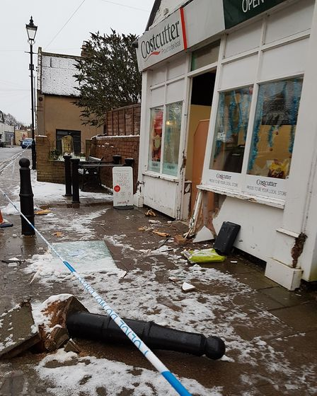 A bollard was knocked over and the front of the shop was damaged. Photo: Cathy Gibb-de Swarte