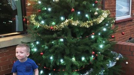 Donna Rudolph's son Oscar in front of their Christmas tree at their March home.