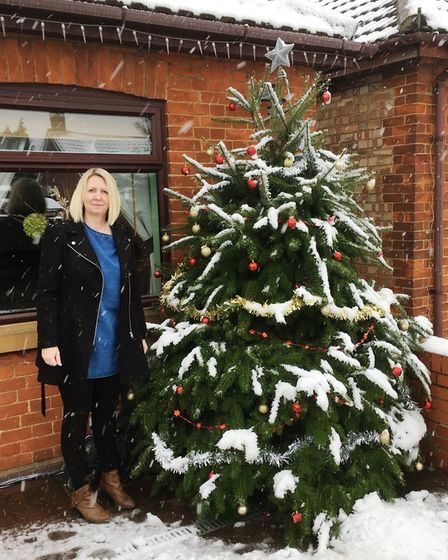 Donna Rudolph's Christmas tree outside her March home.
