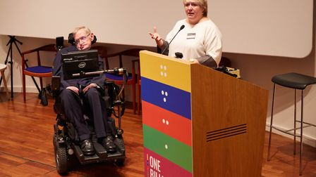Professor Hawking is presented with a sculpture by Sightsavers CEO, Caroline Harper, of the genetic