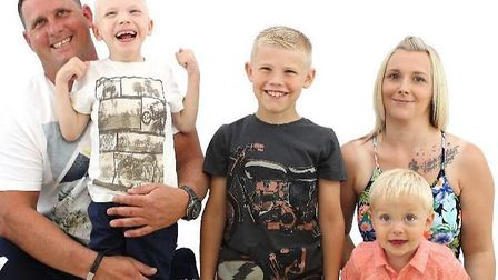 Carly Brown and Glen Chatters with their three boys