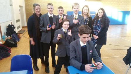 Ely College students share their fascination with Rubik_s Cube puzzles and compete in-house challeng