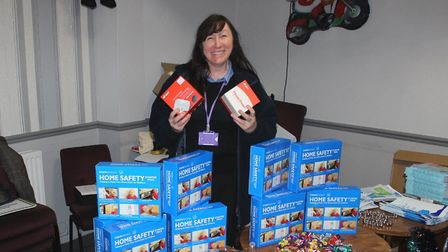 Rosie Cooke, from FDC's community safety team, with some of the free home safety items available to