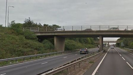 A man died after falling from a bridge over the A14 and being struck by an HGV near Histon last nigh