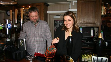 Mike Connelly of the Royal Standard, Ely, shows Lucy Frazer the best way to pour a pint.