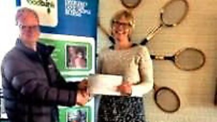 Cathy Wright, project director at Ely Foodbank, receiving the cheque for over £400 from Tennis Club