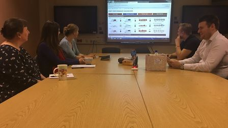 """""""Discussing the key performance stats with the Business Intelligence and Performance team at their m"""