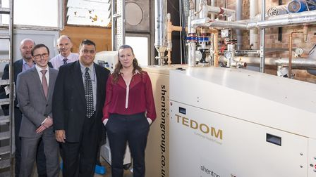 Pictured in the Hudson Centre plant room, with the new combined heat and power system, are from left