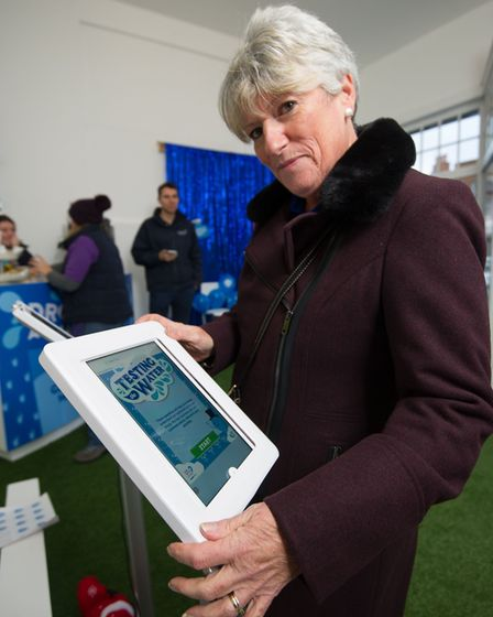 A Newmarket resident takes a Water Quiz in Anglian Waters Smarter Drop Shop. Photo: Matthew Power