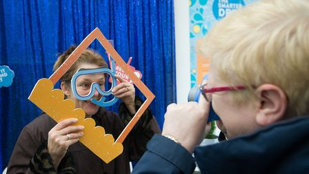 Meleena Walsh enjoys the photo booth at Anglia Water's pop-up shop in Newmarket. Photo: Matthew Powe