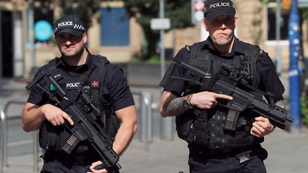 The public may see armed officers on the streets around Cambridgeshire's retail centres.