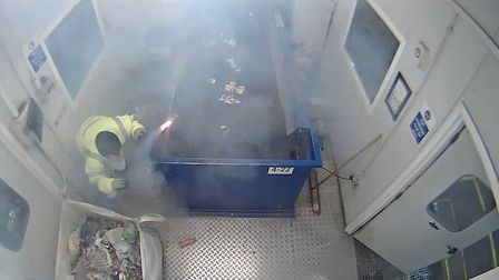 This is the moment a marine flare explodes in a man's hands and ricochets around the room. PHOTO: Am