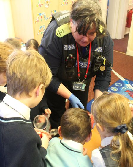 Children at King's Ely Acremont turned into mini crime scene investigators under the watchful eye of