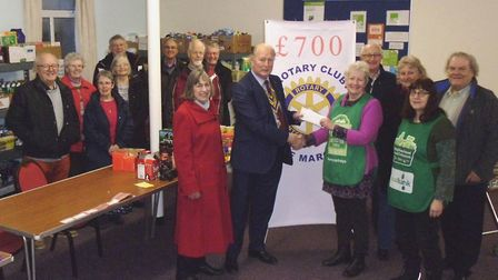 March Food Bank surprised with £700 donation from the Rotary Club, left to right, front row, Susan M