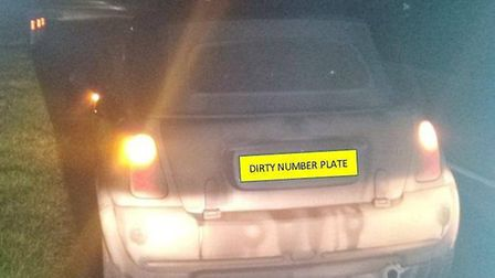 East Cambs Police stopped a driver with number plates that could not be seen for dirt - only to find