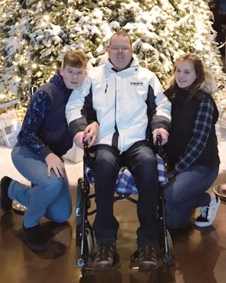 Gavin Bailey of Papworth, pictured with his two children. PHOTO: Charity Today
