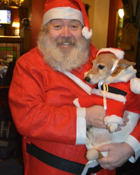 Ely artist Ian McKendrick with his dog Lola before having his 'Santa beard' shaved off for charity.
