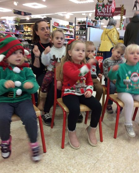 Children from the Maple Grove Community Group have raised around £150 singing in Sainsbury's.