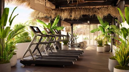 The gym overlooking the ocean at Hotel Jardin Tropical