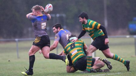 Nathan Brooks fails to hold on to a pass in the wet conditions