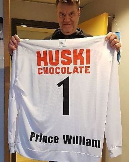 Anders Hagbo, chief executive officer of Hammerby and Zinken Stadium, holding Prince William's bandy