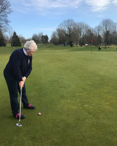 Ann Russell putting out - Ely Golf Club captains raise over £7,000 for the Addenbrooke's stroke ward