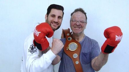 Middle weight champion and Peterborough sports personality of the year Marcello Renda with a FACET s