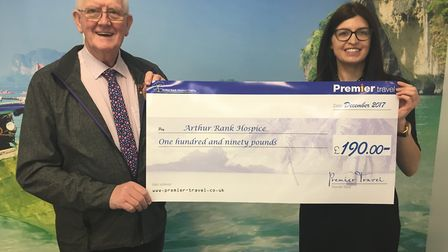 Ely travel consultant Laura Ashley presents a cheque to Robert Barnes in aid of Arthur Rank Hospice.