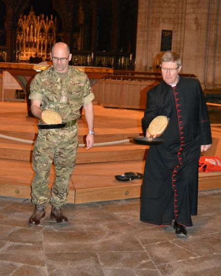 The pancake race between the Dean Mark Bonney and Lt Col Neil Stace ended in a draw