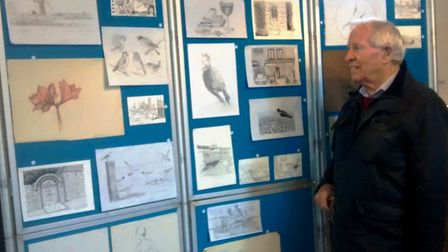 Don Beards looking at some of the sketches