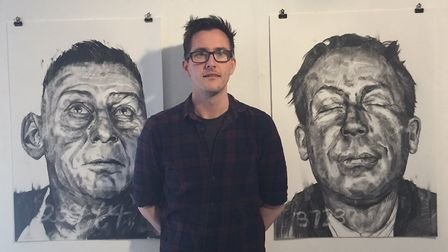 Oliver Winconek pictured with two works from his 'Mugshot: Painting the least wanted' exhibition