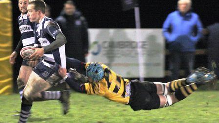 Tom Holloway's last ditch tackle stops another Cantabs attack