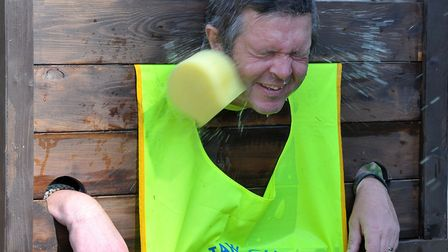 The Whittlesey Festival 2014. Cllr Martin Curtis getting wet from the sponges. Picture: Steve Willia
