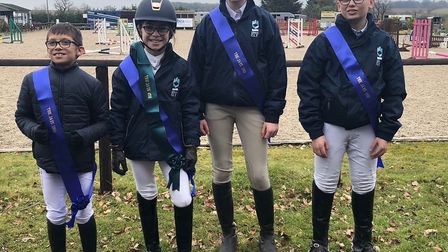 Four members of King's Ely's equestrian team have qualified for one of the UK's largest horse shows.