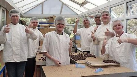 Harry Specters staff making some of their sweet chocolate treats