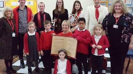 Britten Sinfonia with music teacher Yasmin Bean, right, and Councillor Lis Every, left, at Spring Me
