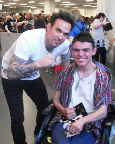 William Storey is fund raising for a stand up electric wheelchair. Seen here with Power Rangers acto