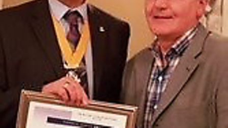 John Barlow, Rotary Club of Chatteris vice-president, presenting the rotary community certificate to