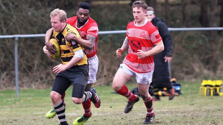 Paul Dewey tries to miss the tackle while Ely attack. PHOTO: Steve Wells.