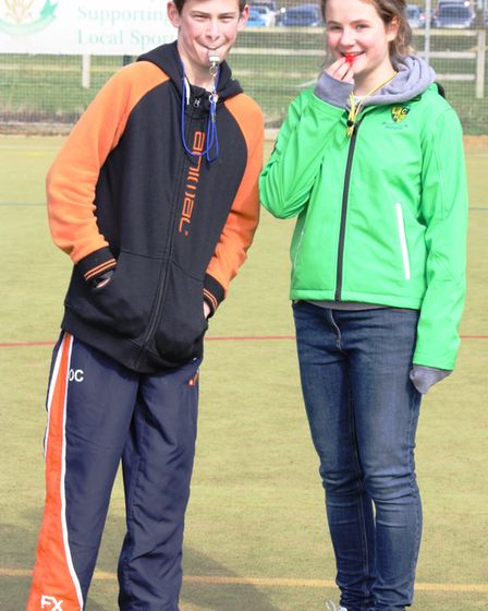 Ely City Hockey Club Juniors Owen Carford and Annabelle Gilbert who helped umpire the under eight ma