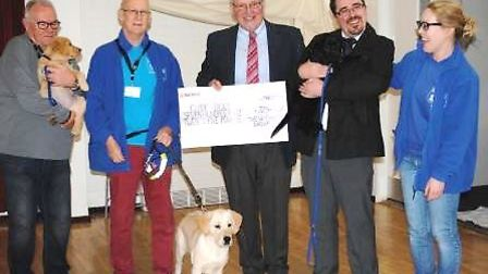 David Crabb and Tom Reader from Withams Soham depot presenting a cheque to the Guide Dogs for the Bl